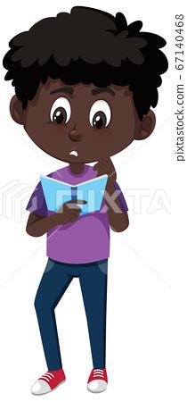 Boy reading a book 67140468