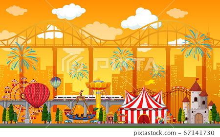 Amusement park scene at daytime with fireworks in 67141730