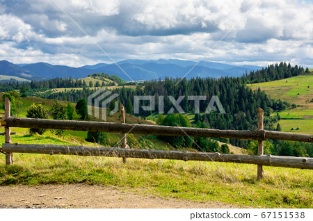 fence on the hill in rural area. early autumn 67151538