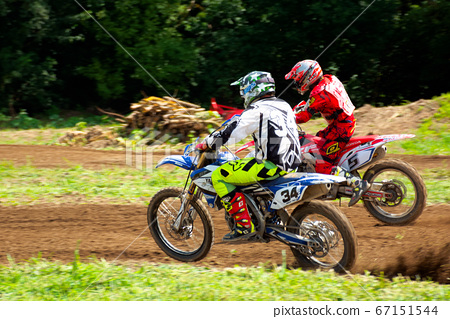 motocross riders in action 67151544