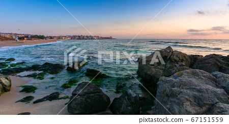 idyllic sunset on the sea shore. waves crashing 67151559
