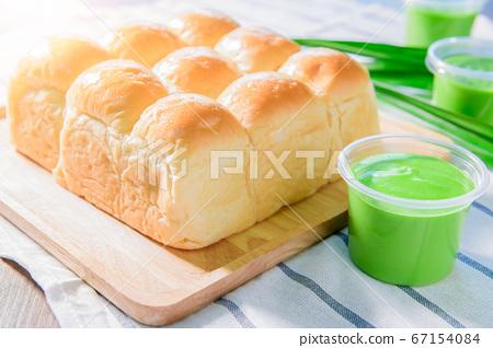 Soft bread home made with Pandan Custard Bread 67154084