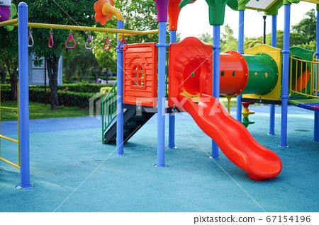 Playground for kid children having fun with colorful slide  67154196