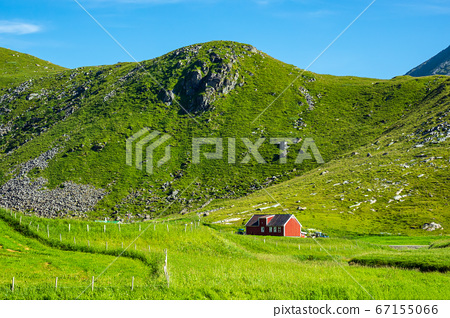 Mountains and farmstead on the Lofoten islands in 67155066