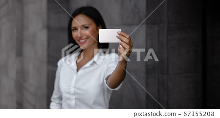 Business Card Mockup Image. a Smiling Mixed Races 67155208