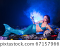 Ocean plastic pollution. Mermaid have fun in water with plastic garbage. Stop plastic pollution. Fairy tale and reality concept. 67157966