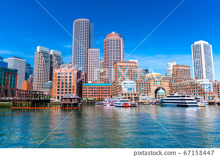 Boston cityscape reflected in the water, skyscrapers and office buildings in downtown, USA 67158447