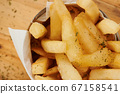 Crispy french fries in cup 67158541