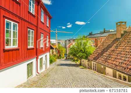 Old wooden houses in Oslo, view of one of the oldest streets in the city, Norway 67158781