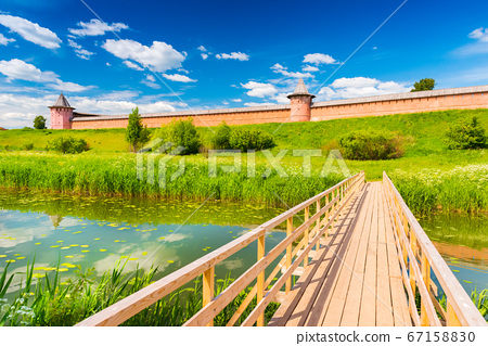 Wooden bridge across the river. Suzdal, the famous Russian town, part of The Golden Ring of Russia 67158830
