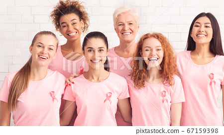 Ladies Smiling Wearing T-Shirts With Pink Ribbon On White Background 67159398
