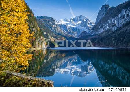 Autumn scenery with Dachstein mountain at sunrise in fall 67160651