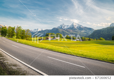Empty asphalt country road with alpine mountain landscape in summer 67160652