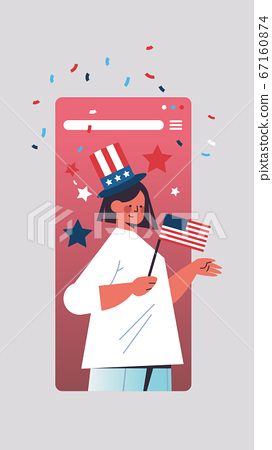 woman in festive hat holding flag celebrating 4th of july american independence day concept 67160874