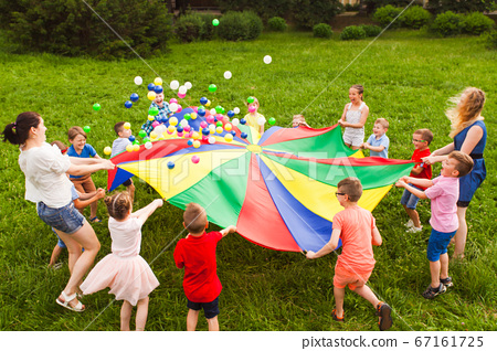 Birthday games on fresh air with parachute and balls 67161725
