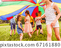 Little girl trying to join active game of older kids 67161880
