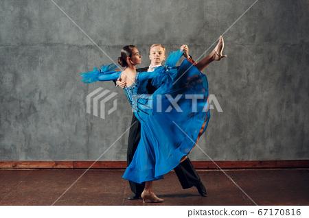 Ballroom dance. Young man and woman dancing foxtrot. 67170816