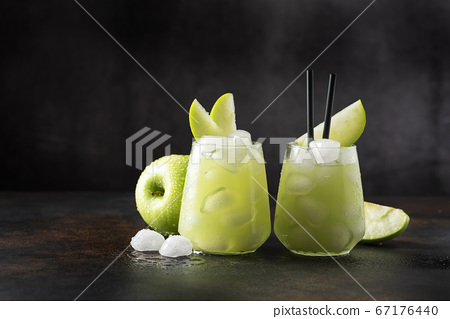 Summer cocktail with green apple 67176440