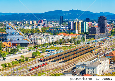 Aerial panorama of Ljubljana with modern buildings and the main train station, Slovenia 67178003