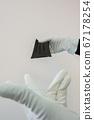 Man holds rubber gloves black face masks 67178254