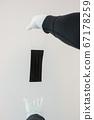 Man holds rubber gloves black face masks 67178259
