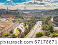 Aerial panorama of Lisbon with highways, overpasses and The 25th April Bridge 67178671