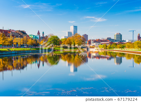 Malmo, Sweden: skyline reflected in the water, urban landscape panorama 67179224