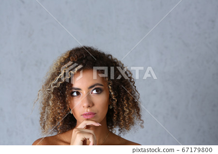 Beautiful black woman portrait. 67179800