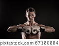 Boxer with strong hands ready to fight 67180884