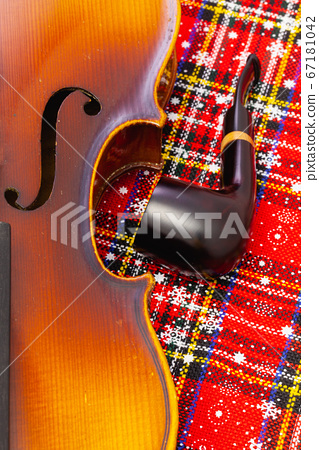 Photo of old violin and luxury wooden pipe on 67181042