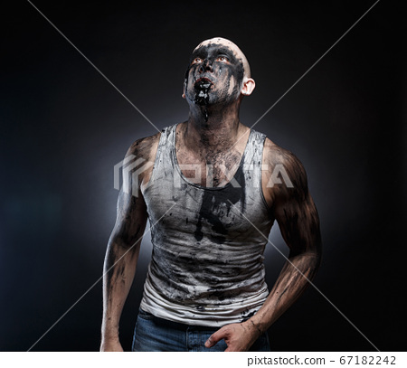 Image of bald man with black goo in the mouth 67182242