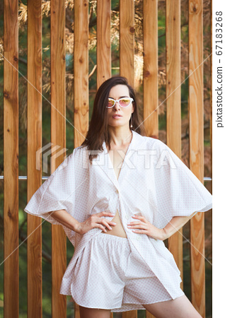 Woman in pajamas over wooden background on terrace. Good morning concept 67183268