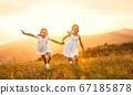 happy children run in nature in summer. 67185878