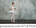 Modern ballet, great design for any purposes. Ballet dancer ballerina. Balance training. Classical choreography style. Beautiful dancer ballerina. Classical music. Elegant ballet style. 67187028