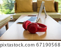 Red headphones and laptop. leisure lifestyle 67190568