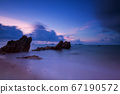Motion seascape with stone arch at dawn 67190572