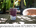 Mix berry smooties in coffee shop wood table 67190579