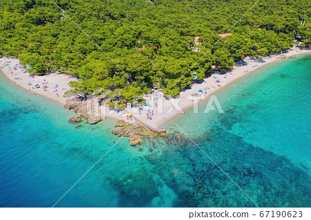 Famous Punta Rata beach with azure sea in Brela, Dalmatia, Croatia 67190623