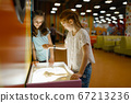 Girls make sand picture in entertainment center 67213236