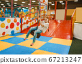 Little girl rides on a swing, entertainment center 67213247