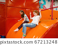 Girlfriends plays among soft cubes, playground 67213248