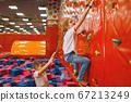Children quarrels on climbing wall, playground 67213249