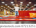 Girl jumping on trampoline in entertainment center 67213251