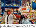Children throw balls in the entertainment center 67213252