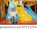Children ride down the hill, entertainment center 67213254