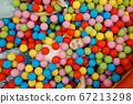 Girl lying among many colorful balls, playground 67213298