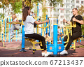 Active family time at the outdoor gym 67213437