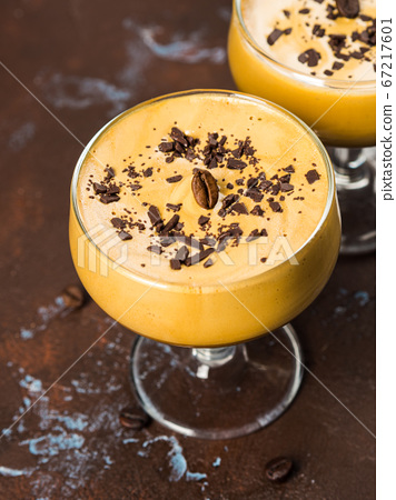 Frappe coffee in dessert glasses on brown backdrop 67217601