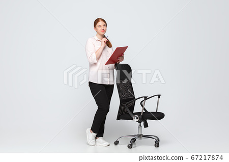 Young caucasian woman in casual wear. Bodypositive female character, plus size businesswoman 67217874