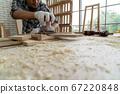 Carpenter working on wood craft at workshop 67220848